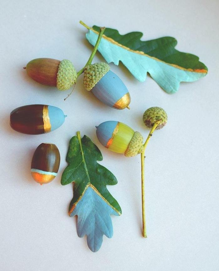 deco en feuilles mortes repeintes de couleurs variées et des glands colorés, bricolage deco a faire soi meme automne
