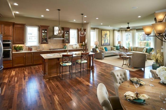 aménagement salon et cuisine, spots encastrés, lampes et plafonnier, sol en bois laqué, table ronde