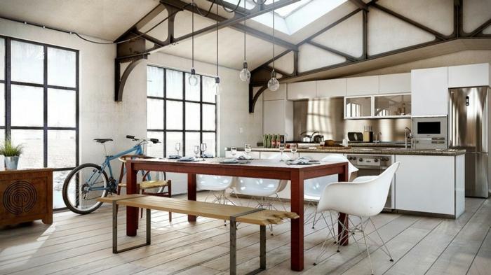 espace style loft industriel, sol en bois, peinture blanche, table de repas en bois, équipement de cuisine blanc