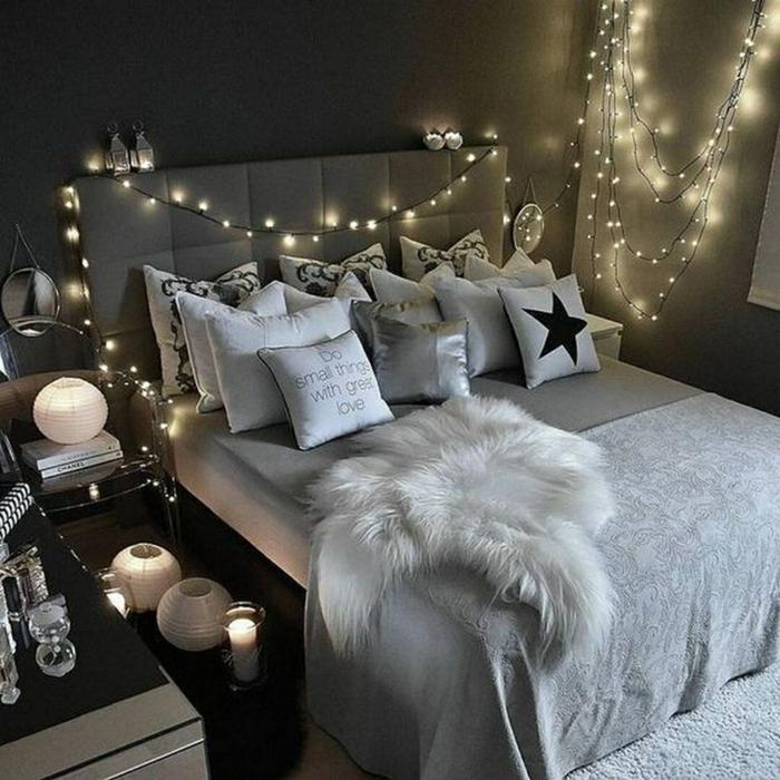 créer sa deco chambre moderne, guirlande lumineuse, fourrure blanche, coussins blancs, peinture grise