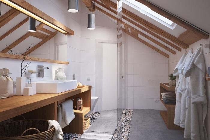 joli modèle de salle de bain contemporain aux murs en carrelage blanc avec poutres de bois exposées et meubles bois