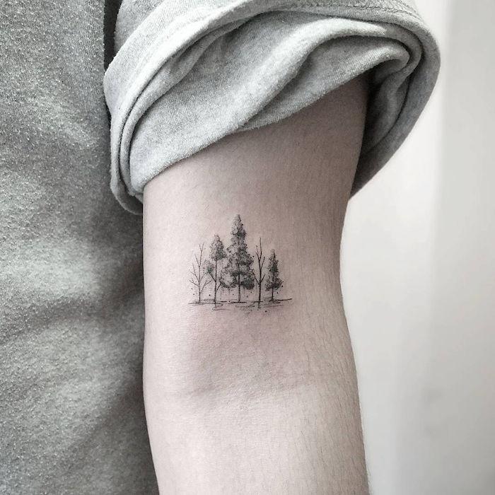 petit tatouage manchette discret paysage arbres en pointillés sur bras homme
