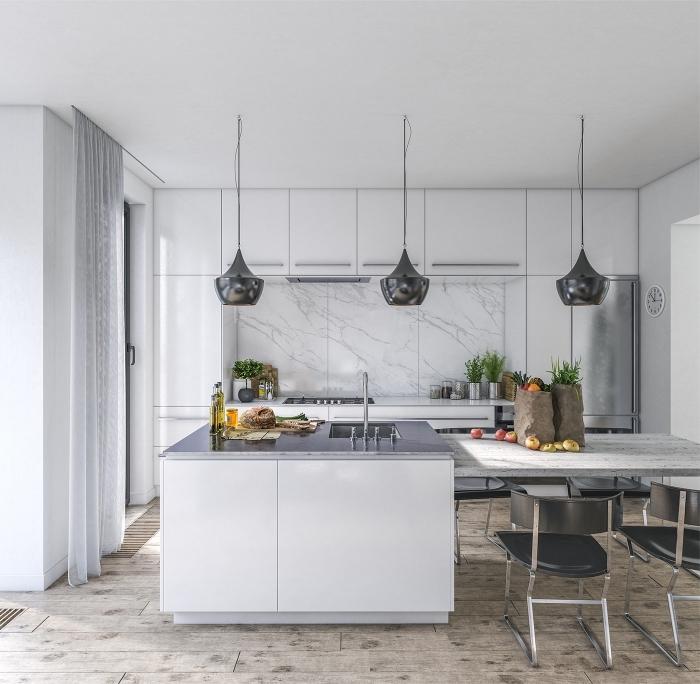cuisine gris clair aux accents métalliques avec îlot central de cuisine à finition laquée à coin repas intégré
