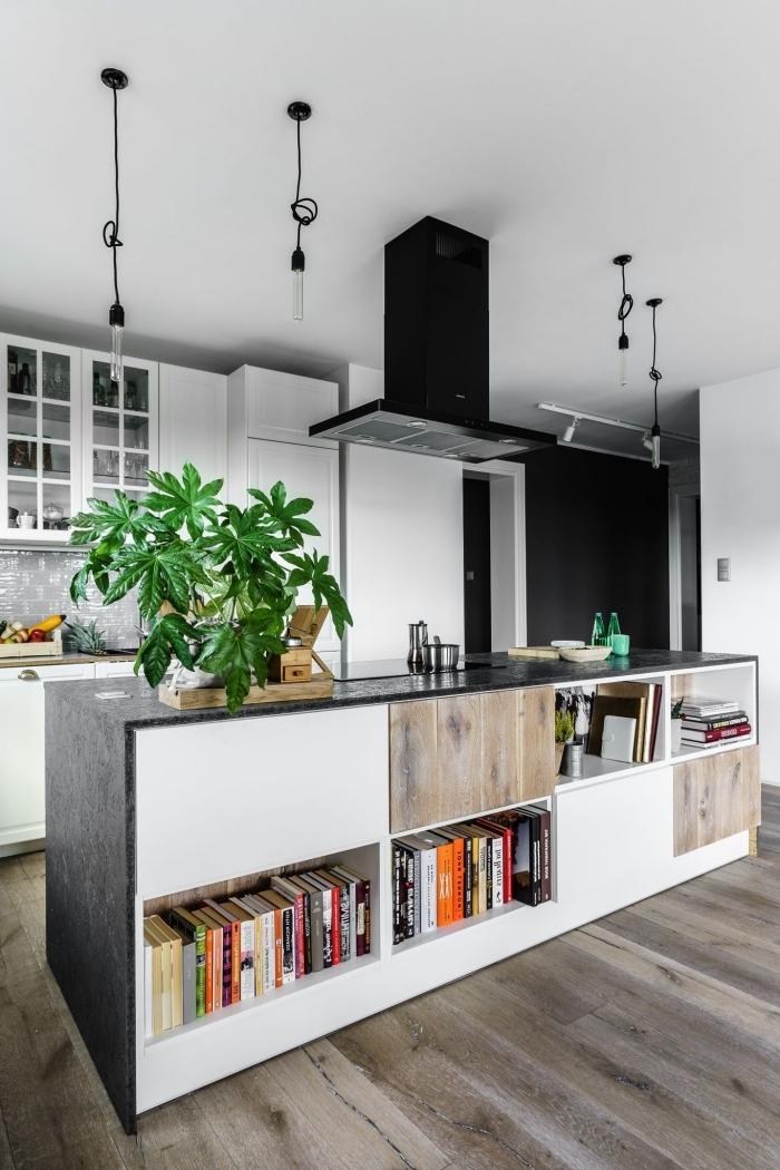 cuisine avec ilot central multifonctions, associant un plan de travail en granite noire à une façade bi-colore, îlot central avec plein d'espace de rangement supplémentaire