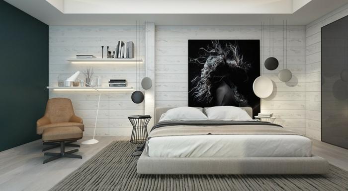 décoration chambre adulte moderne, tapis gris, fauteuil marron, tablettes illuminées, photographie monochrome