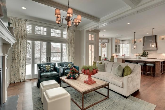 plafonnier élégant, table de salon en bois et fer, sofa gris, cheminée décorative, cuisine americaine