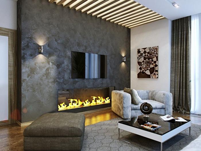 salon gris, table bassen fauteuil gris, grand tabouret, manteau de cheminée gris anthracite, modèle d'applique murale métallique