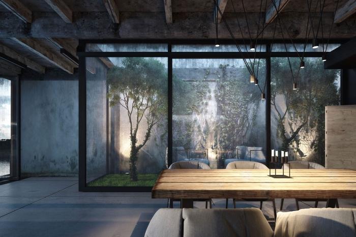 exemple de design intérieur moderne en couleurs foncées aux murs design béton et plafond avec poutres apparentes