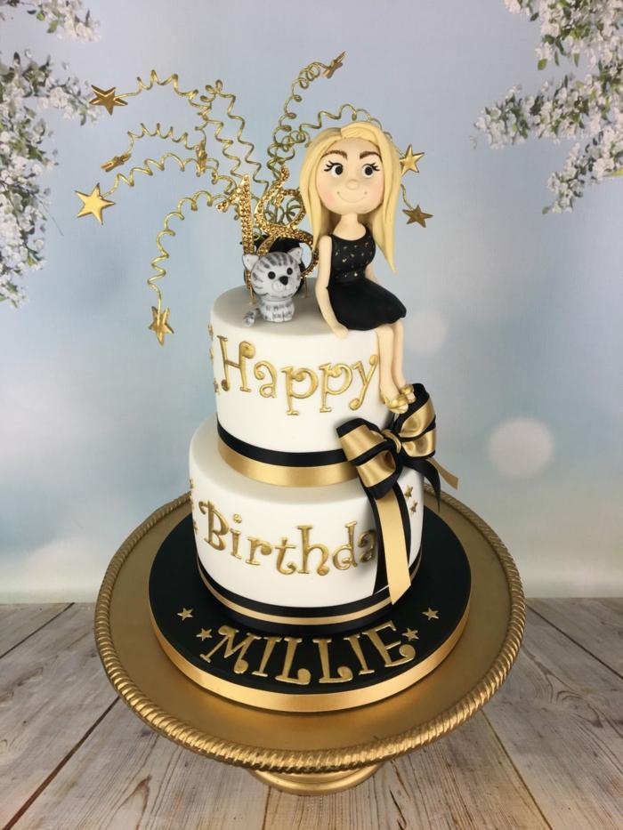 gateau anniversaire fille en noir et blanc, chat et fille qui s'est assise au top du cake
