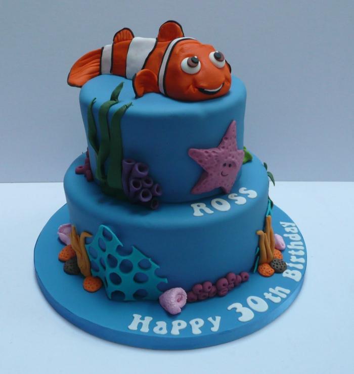 gateau bleu les aventures de Némo, figurines les créatures de la mer, souhaits d'anniversaire