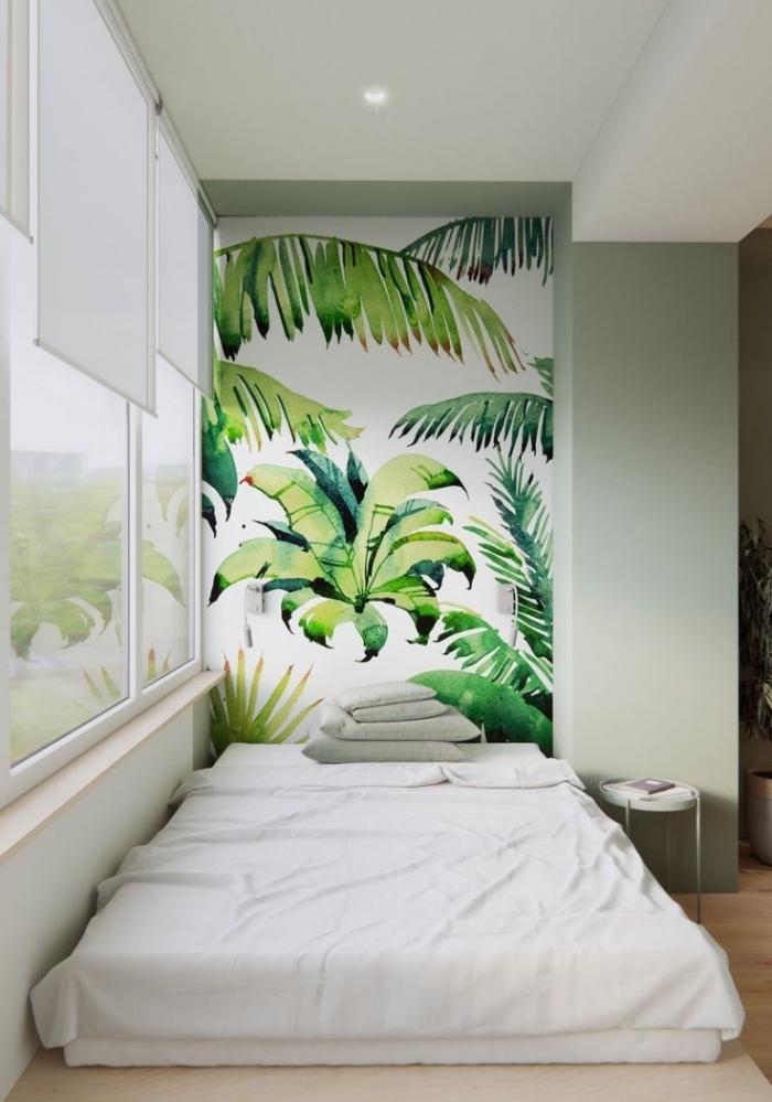 du papier peint tête de lit tropical pour un pan de mur qui invite à l'évasion dans la chambre à coucher relaxante