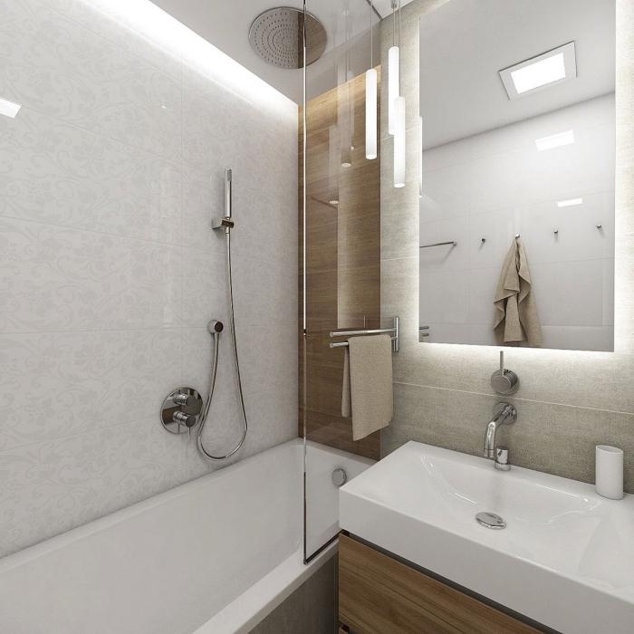 design intérieur stylé dans une petite salle de bain décorée en couleurs neutres avec finitions en métal argent