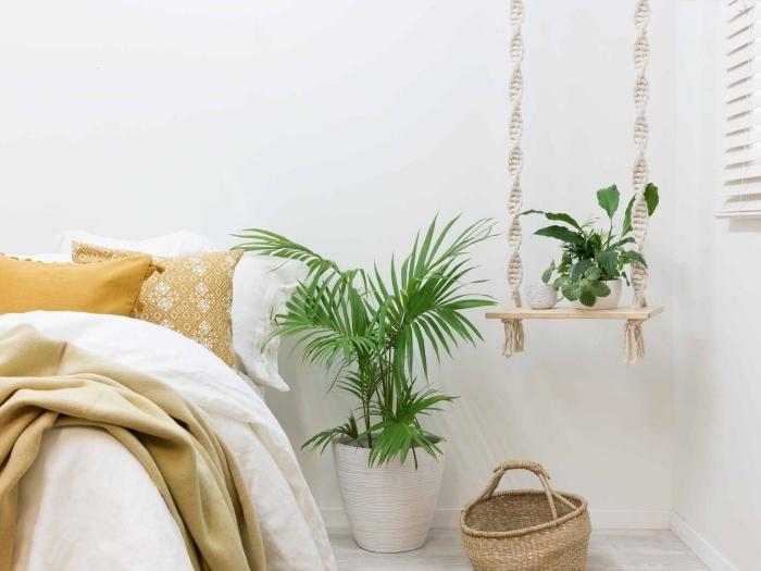 idée suspension macramé avec une planchette de bois et corde twisté pour arranger des accessoires décoratifs dans une pièce bohème
