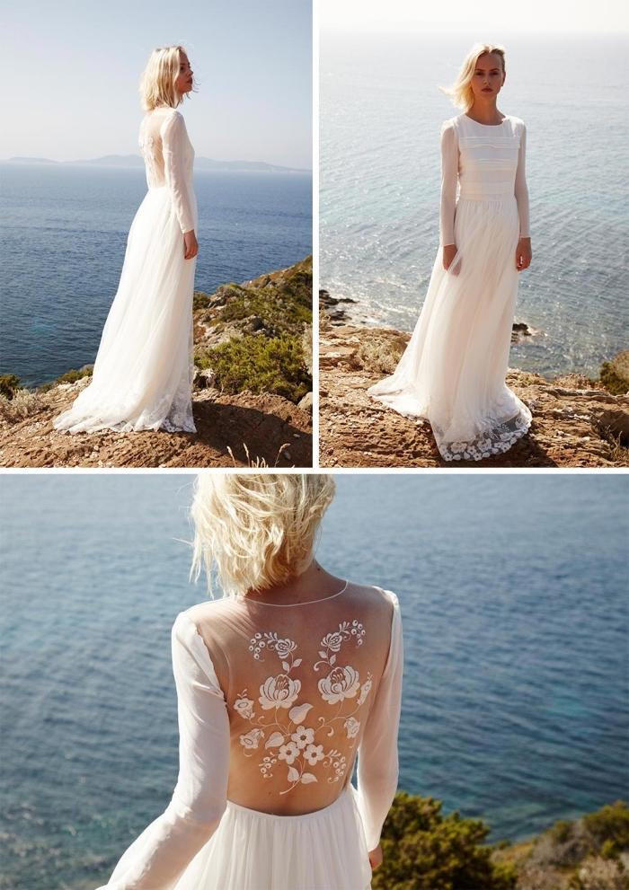 robe de mariée manche longue d'une coupe fluide et bohème, avec un dos semi-nu orné d'accents floraux en fil brodé