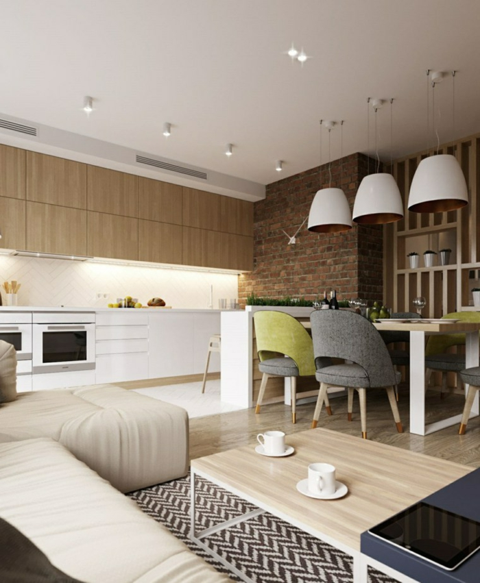 cuisine semi ouverte sur salon avec un petit mur bas, table de repas style scandinave, équipement de cuisine blanc, sofa et table basse