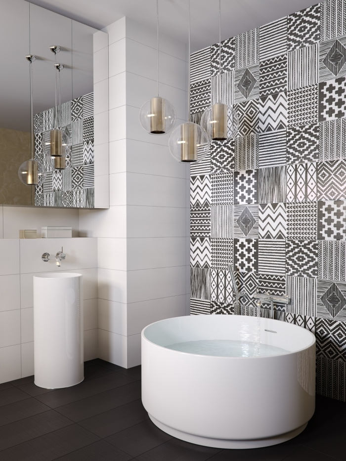 aménagement d'une petite salle de bains avec baignoire ronde, carreaux de ciment patchwork ethniques monochrome qui délimite l'espace baignoire