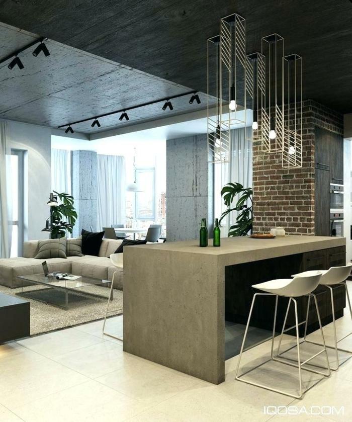 cuisine et salon en gris, chaises blanches, suspensions luminaires originales, plafond gris, grand sofa d'angle, aménagement cuisine ouverte