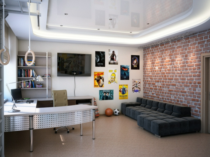 chambre garcon ado style industriel, sofa bas noir, mur en briques, bureau en U, posters muraux et anneaux de gymnastique