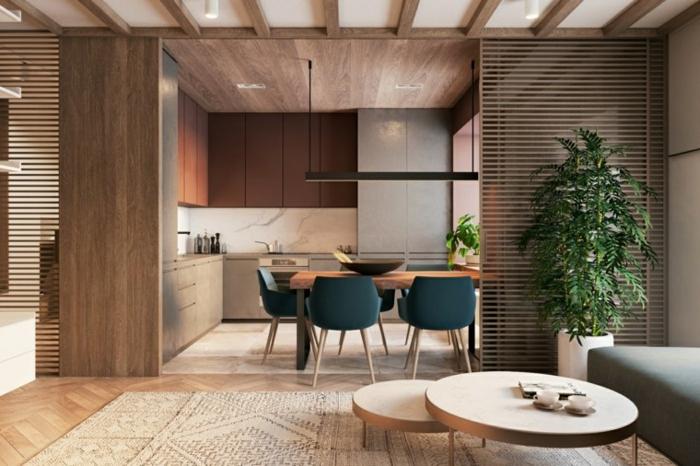 tapis ethnique beige, tables basses en bois, cuisine semi ouverte sur salon, panneaux déco en bois