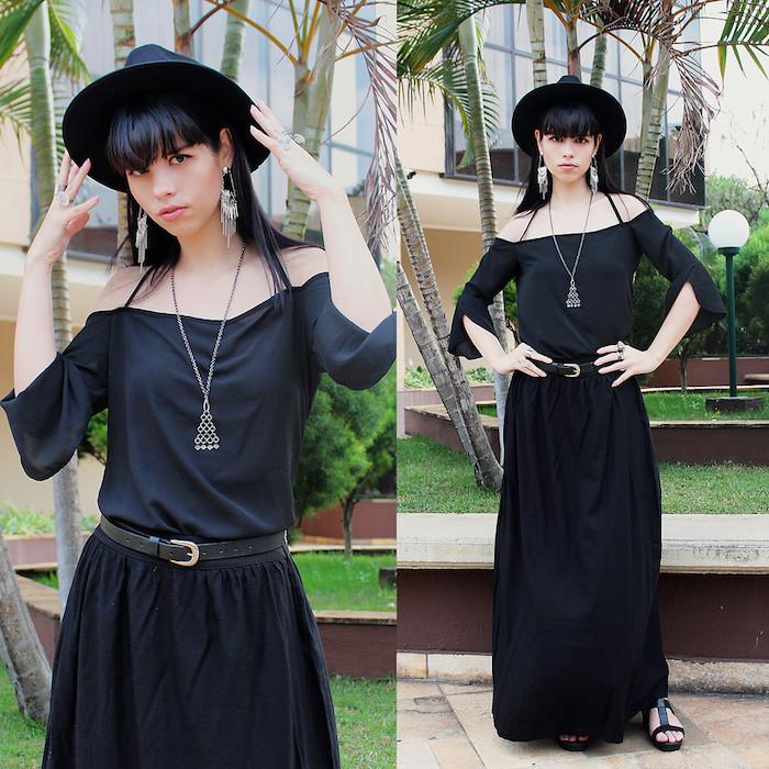 déguisement sorcière halloween en robe noire, capeline noire, collier triangle, boucle d oreille géants, deguisement magicien