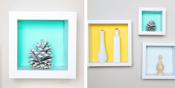 idée deco avec pomme de pin moderne, objet de déco facile avec une pomme de pin colorée en blanche dans cadre