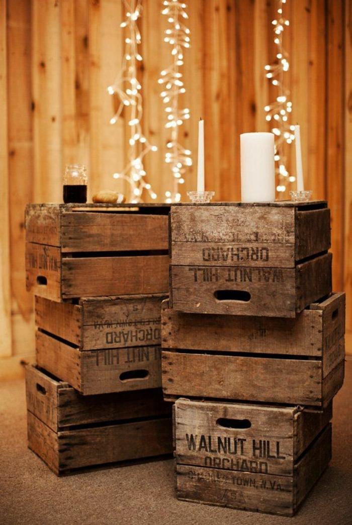 mariage theme champetre, guirlandes lumineuses et bougies, caisses de bois