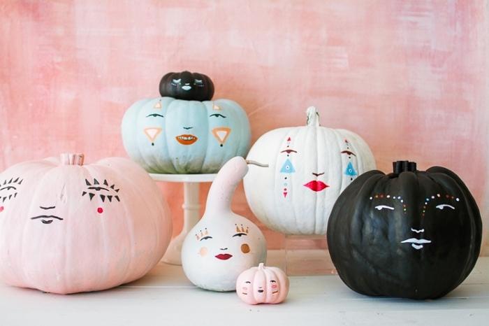 déco mignonne avec citrouille halloween, idée comment peindre une citrouille et dessiner un visage effrayant pour Halloween