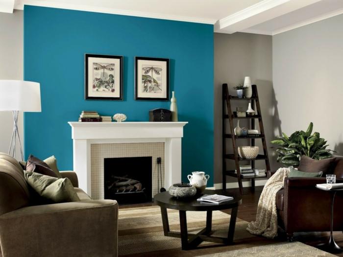 cheminée murale blanche, étagère échelle, table basse noire, fauteuil beige, couleur peinture salon