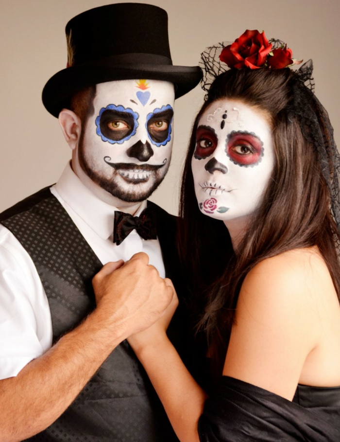 maquillage halloween mexicain, chapeau cylindre, cernes noirs et bleus, moustache et dents, femme avec chapeau filet