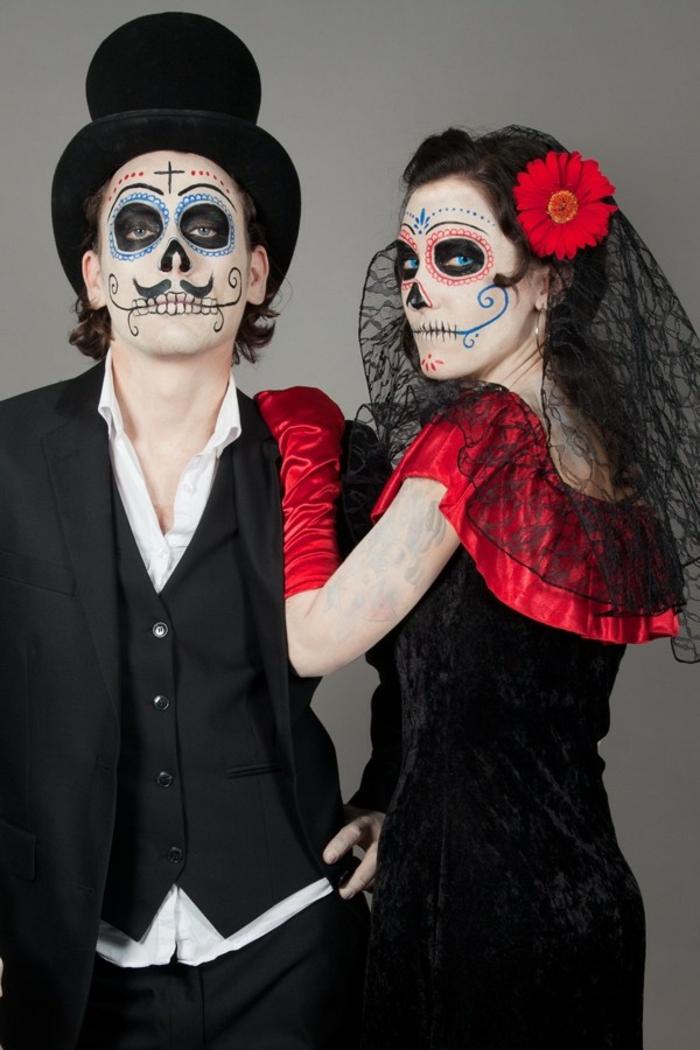 idee deguisement duo, costumes noires, maquillage tête de mort, cylindre noir, robe en rouge et noir, fleur rouge