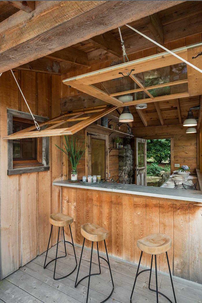 photo terrasse et cuisine extérieure bois rustique semi ouverte avec bar