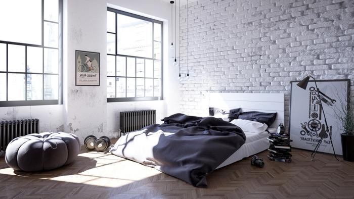 grande chambre lumineuse, fenêtres d'artiste, mur en briques blanches, lit cocooning au sol