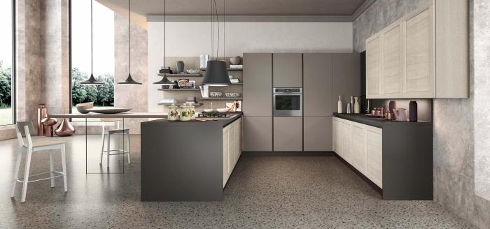 design intérieur contemporain dans une cuisine stylée aménagée avec îlot central bicolore équipé de plaque cuisson