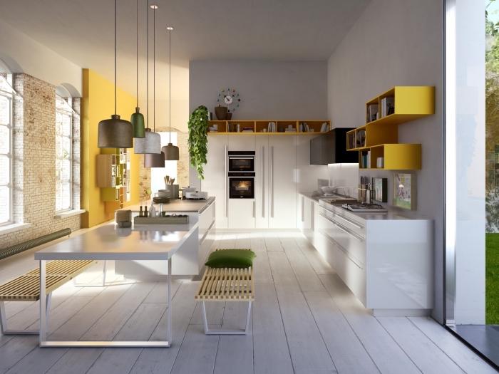 cuisine ouverte avec ilot bicolore en blanc et gris, déco moderne avec mur industriel et meubles à design géométrique