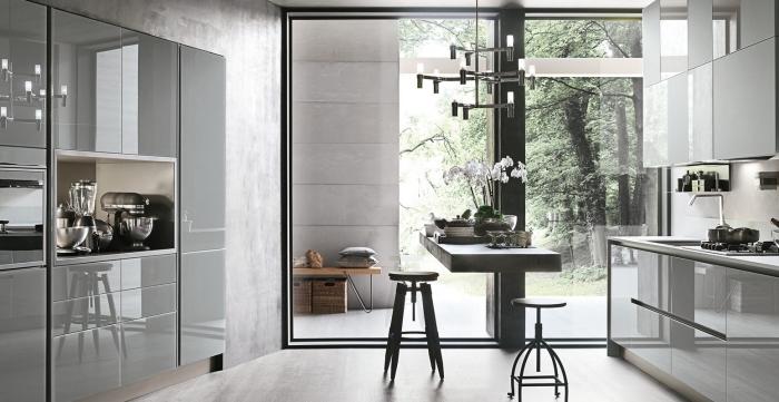 comment aménager une cuisine contemporaine avec petit îlot central, design intérieur aux lignées épurées avec meubles en couleurs neutres