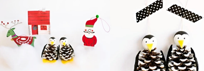 comment faire des ornements de noel, couple de pingouins diy en pommes de pin à accrocher sur le sapin de noel