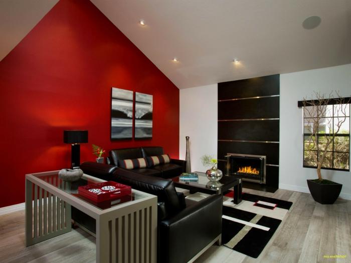 grand salon moderne, cheminée murale, tapis graphique, sofa noir, decoration salon peinture
