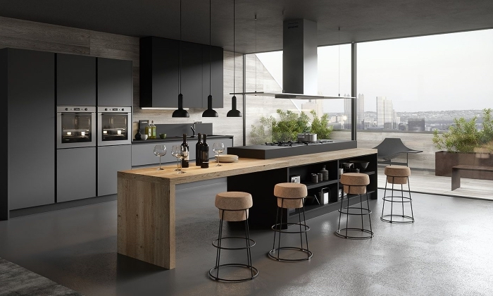 cuisine bois et noir mate équipée d'îlot central bicolore en longueur avec tablette bois et plaque de cuisson