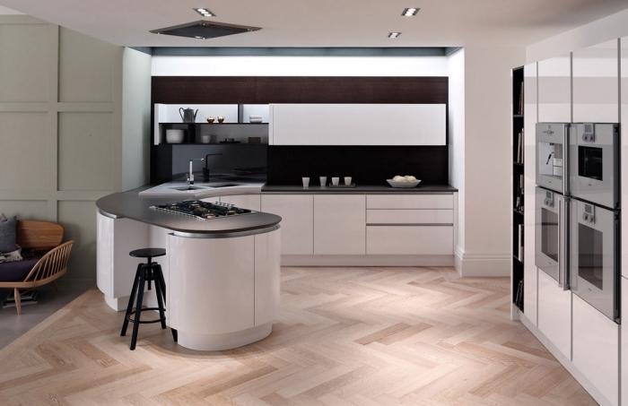 comment aménager une cuisine avec îlot central circulaire, idée de déco dans une cuisine ouverte vers le salon