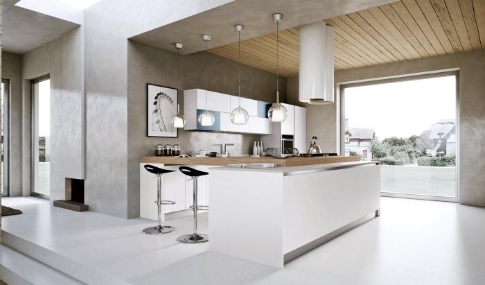 design intérieur dans une cuisine ilot central moderne aménagée en couleurs neutres, modèle de cuisine avec îlot en bois et meubles blancs sans poignées