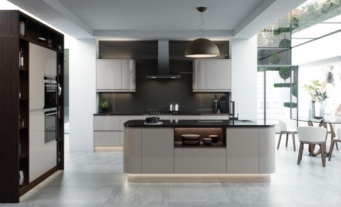 comment aménager une cuisine ouverte sur le séjour avec meubles modernes et îlot bicolore à design rangement ouvert