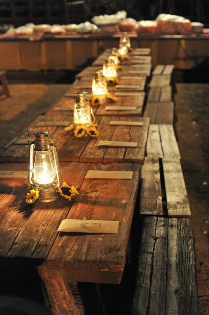 table longue rustique, lampes de gaz rustiques, bancs de bois brut, déco mariage champêtre
