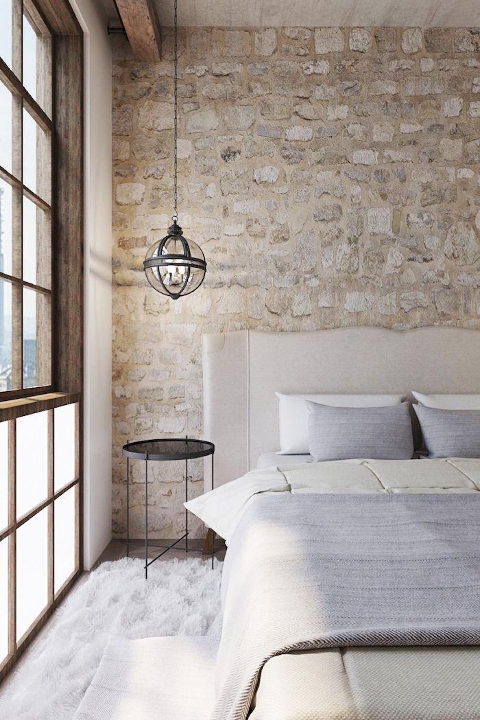 mur de chambre avec pierres ou imitation,  cadre de fenetre en bois et lampe suspendue design