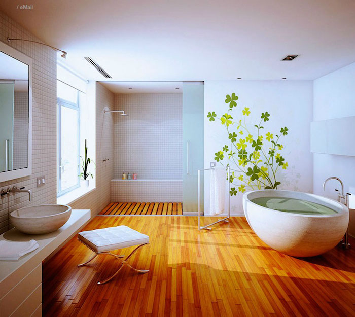 grande salle de bain sur parquet avec baignoire ilot et douche italienne sur bois, sticker mural plante trefles