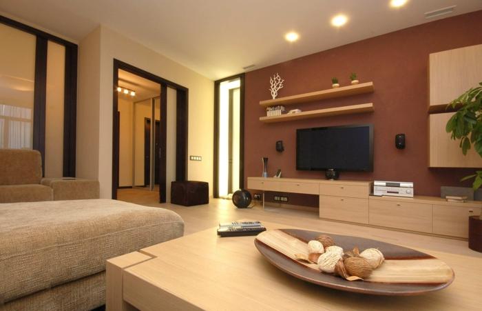 grande table en bois clair, peinture mur marron, étagères, meuble de tv, unités suspendues, grand sofa beige
