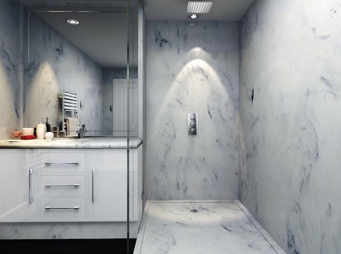 salle de bain san carrelage avec douche italienne en béton marbré blanc bleu
