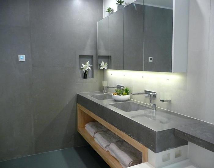 revetement mural salle de bain en béton ciré sans carrelage et meuble lavabo en dur en ciment
