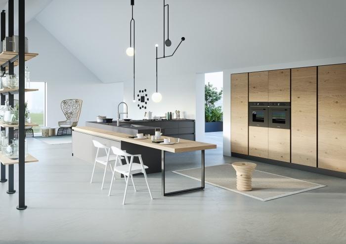 design intérieur de style moderne dans une cuisine en u avec îlot en gris et bois, modèle de meuble rangement en bois et fer