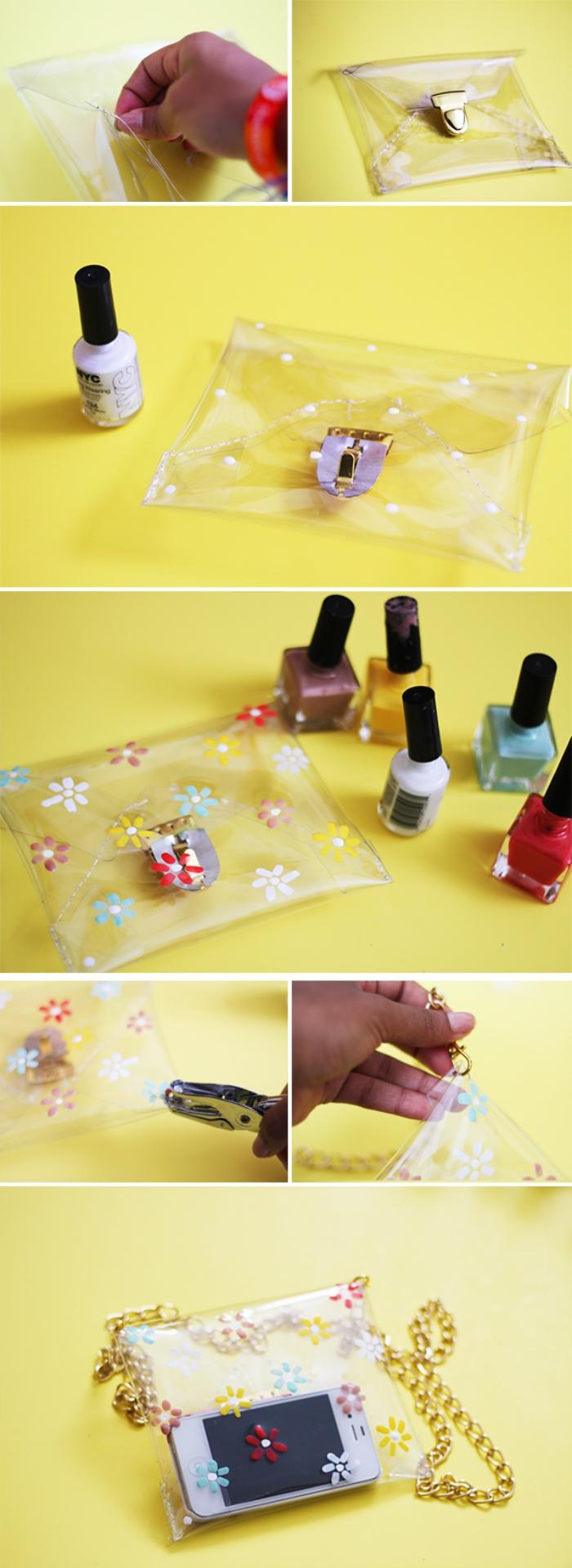 sac pochette transparente à motifs fleurs dessinés au vernis d'ongles, muni d'une chaînette dorée