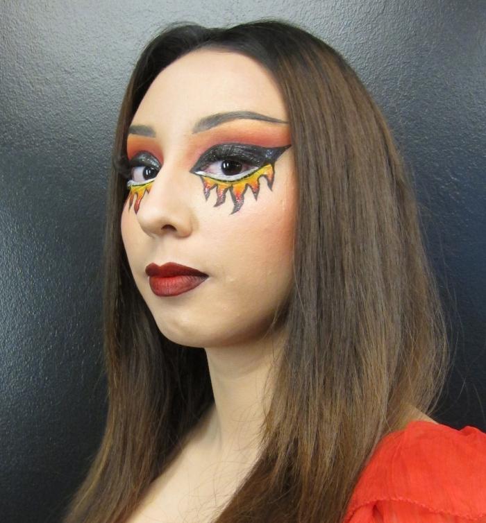 idée de look de femme et de maquillage halloween diable avec des yeux en feu et une bouche rouge